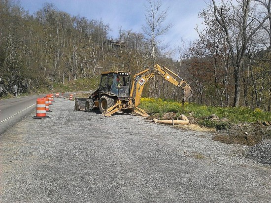 A backhoe sets up erosion control along the southern end of the U.S. 321 widening project in Blowing Rock after the early May storms. Photo:NCDOT