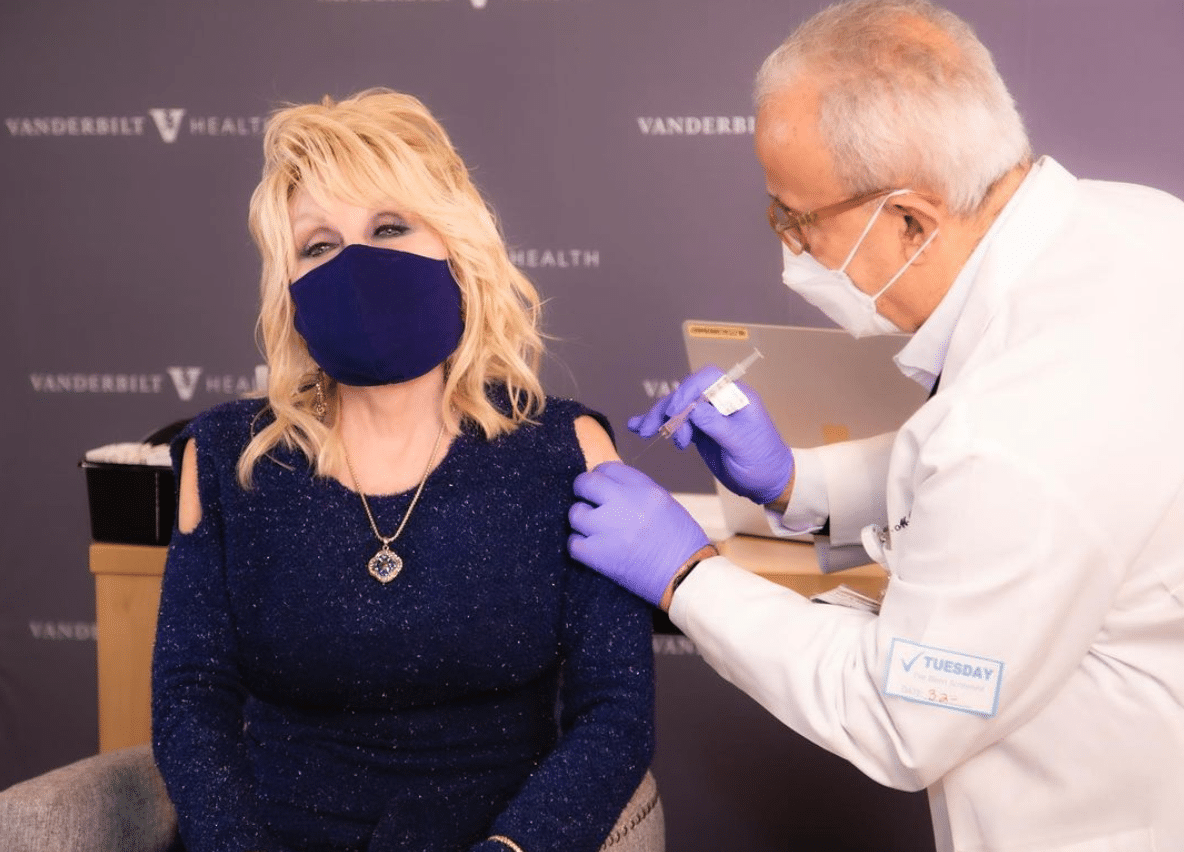 """Dolly Parton gets """"a dose of her own medicine""""with COVID-19 vaccine"""
