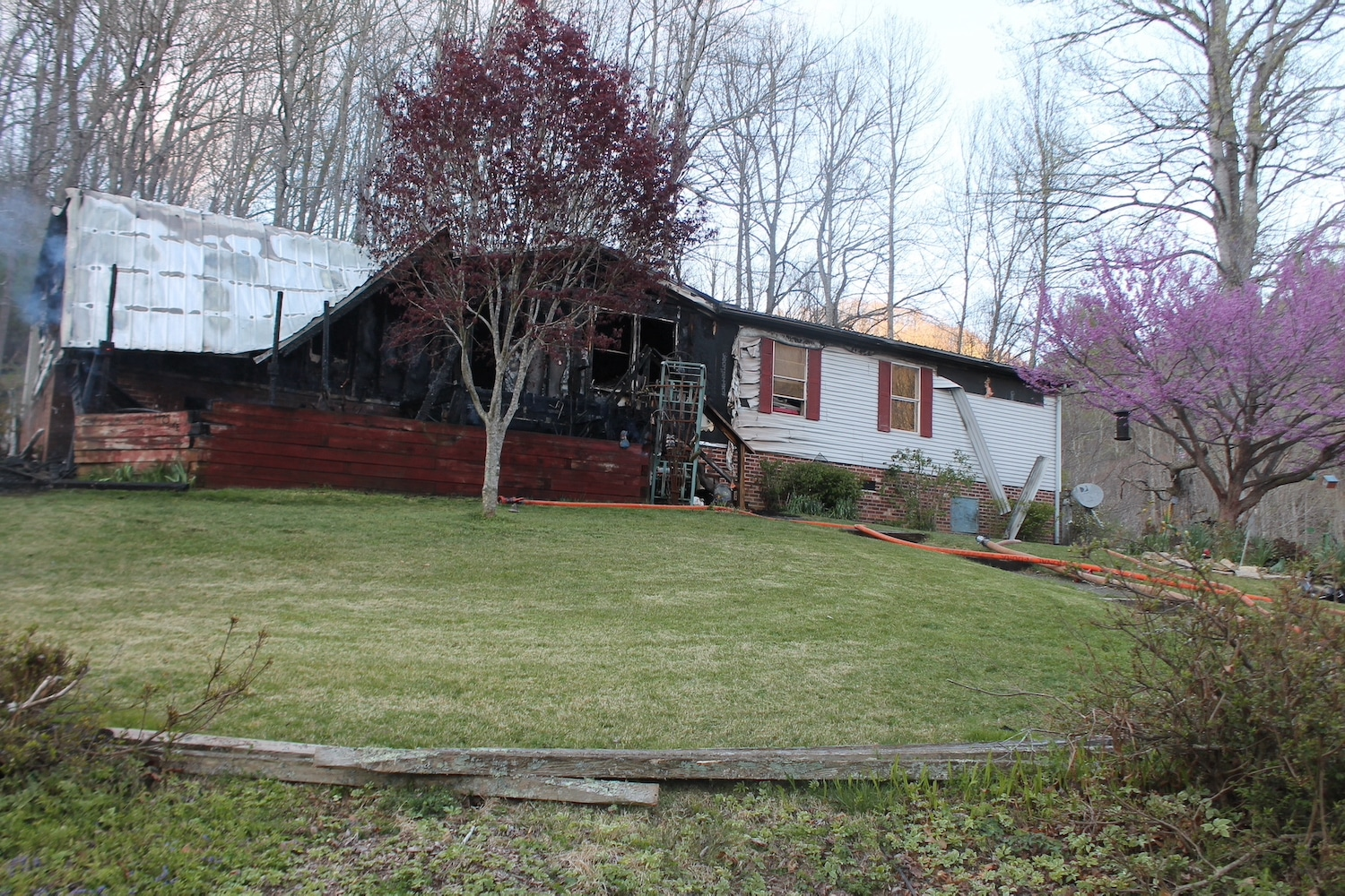 Double wide home total loss after fire caused by lawn mower